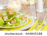 a plate with a fresh caesar... | Shutterstock . vector #444845188