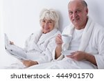 older woman is reading a... | Shutterstock . vector #444901570