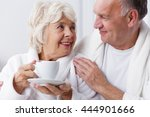 older woman is drinking a cup... | Shutterstock . vector #444901666