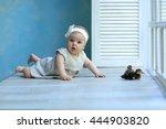 Baby Lies In A Beautiful Dress...