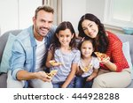 Portrait Of Happy Family Eatin...