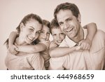 smiling young family looking at ... | Shutterstock . vector #444968659