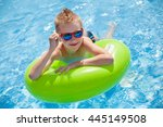 little boy swimming in the pool ... | Shutterstock . vector #445149508
