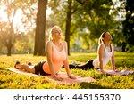 Women Doing Yoga Outdoors In...