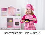 little girl in chef hat and... | Shutterstock . vector #445260934
