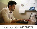 young designer working on... | Shutterstock . vector #445270894