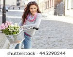 woman wearing a spring skirt... | Shutterstock . vector #445290244