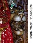 Small photo of head of lion precious stone marble wood statue of a Hinduism women Shiva vishnu Brahma in a temple near a lake in mauritius africa