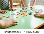 child hands with wooden toy...