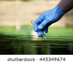 water sample. hand in glove... | Shutterstock . vector #445349674