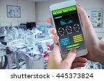 hand holding smartphone against ... | Shutterstock . vector #445373824