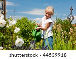 Little Girl Watering The...