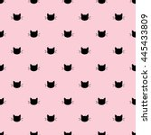 Stock vector seamless pattern of black heads of cats on pink background vector illustration animal silhouette 445433809
