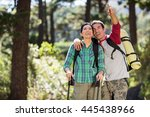 couple pointing and hiking on... | Shutterstock . vector #445438966