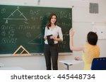 teacher answering pupils... | Shutterstock . vector #445448734