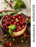 Wild Strawberry In Wooden Bowl