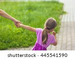 Little Girl Holding A Hand Of...