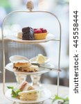 Small photo of Afternoon tea sets with chocolate cake, strawberry tart, scone and sandwiches