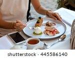 closeup of woman eating desert...   Shutterstock . vector #445586140