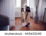 the little girl measures the... | Shutterstock . vector #445633240