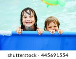 children swim in the pool in... | Shutterstock . vector #445691554