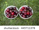cherry berries in a two bowls... | Shutterstock . vector #445711378