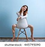 Beautiful Young Woman Sitting...