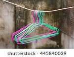 colorful clothes hang on a shelf | Shutterstock . vector #445840039