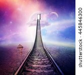 Small photo of Railroad of opportunity along a cracked desert ground, going up as a staircase to a opened door in space, road to heaven symbol. Success plan, business concept