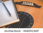 notebook and pencil on guitar... | Shutterstock . vector #446041369