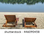 Pair Of Wooden Deckchairs At...