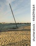 A Catamaran Sitting On A Beach