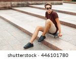 young handsome man sitting on a ... | Shutterstock . vector #446101780