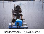 Small photo of soft focus paddle wheel aerator,aerator turbine in shrimp pond in rainy day.