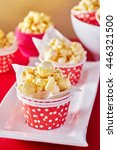 a red paper cup with popcorn... | Shutterstock . vector #446321500