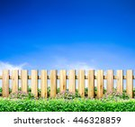 green grass and wood fence on... | Shutterstock . vector #446328859