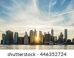 sunburst between buildings of... | Shutterstock . vector #446352724