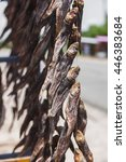 Small photo of Lot of bundles of dried Gobiidae fish. Strange street food.