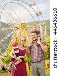 cute young family enjoying a... | Shutterstock . vector #446436610