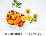 Apricots In A Basket On White...