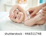 doctor taking baby's... | Shutterstock . vector #446511748