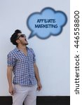 Small photo of The young man says in the speech bubble from his mouth Affiliate Marketing.