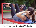 Fit Young Woman Working Out In...