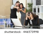 Small photo of Two businesspeople bullying a sad colleague that is sitting in her workplace at office
