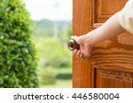 women hand open door knob or... | Shutterstock . vector #446580004