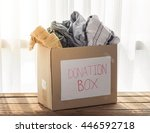 clothing donation box on wooden ... | Shutterstock . vector #446592718
