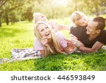 family playing in the park on... | Shutterstock . vector #446593849