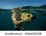 diver taking underwater photo. | Shutterstock . vector #446605108