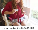 young woman smiling happy while ... | Shutterstock . vector #446645704