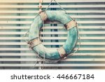 vintage life buoy on a wooden... | Shutterstock . vector #446667184